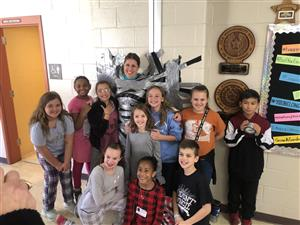 Principal Duct-taped to wall for fundraiser