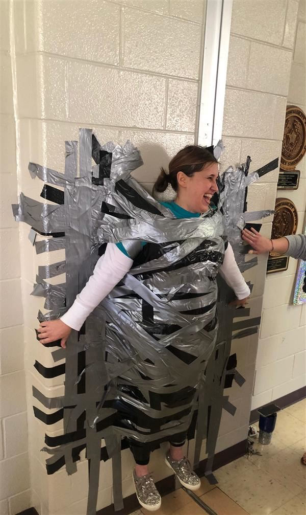 Principal Duct taped to wall