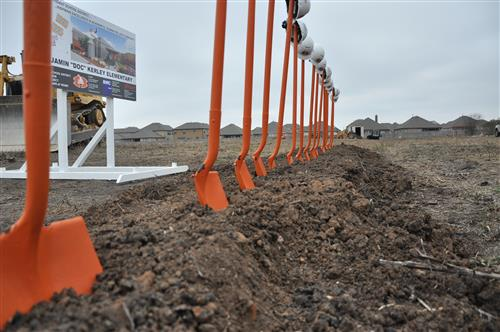 Shovels standing in dirt ready for groundbreaking