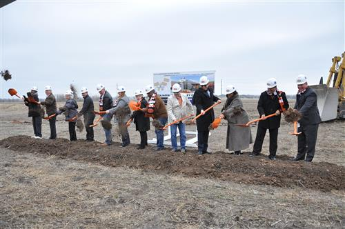 Group throws dirt from shovels to signify groundbreaking