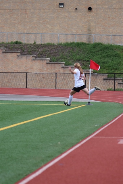 Emma Jones kicking soccer ball from corner