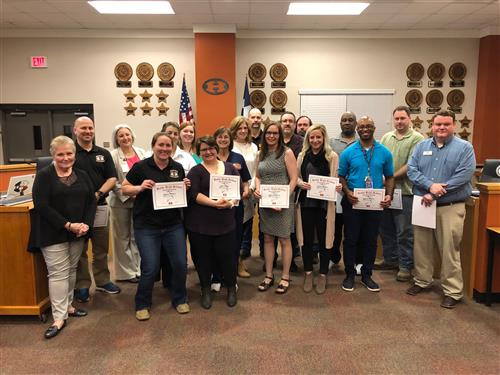 CTE teachers holding certificates for National CTE Month